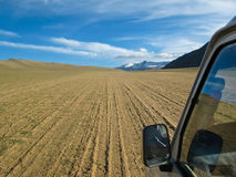 Car offroad on a sand dune in Ladakh Royalty Free Stock Photography