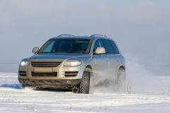 Car offroad in snow on field Stock Image