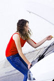Car oil. Woman fixing car checking oil Royalty Free Stock Images