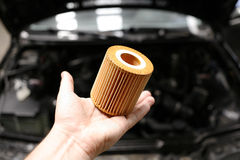 Car oil filter in mechanic hand Royalty Free Stock Photos