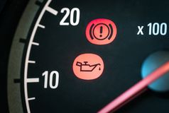 Car with oil and hand break icon. Warning, maintenance and service lights in dashboard. Vehicle panel with red indicator symbol. Service or maintenance needed royalty free stock images