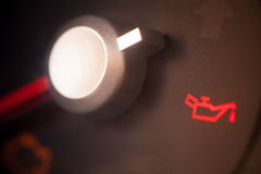 Car oil icon. Detail of the dashboard of a car, with the oil alert icon lit up royalty free stock photos