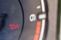 Car oil icon. Detail of the dashboard of a car, with the oil alert icon lit up stock images