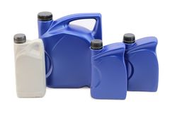 Car oils isolation. Automotive oils in plastic cans on white background isolation Stock Images