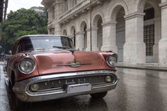 Car in Old Havana, Cuba. Vintage car under the rain in Havana, Cuba stock images