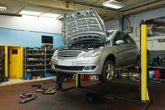 Free Car On A Lift In Garage Stock Photos - 38684563