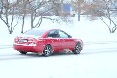 Car On A Snow-covered Road After High Snow-storm In Moscow Stock Images