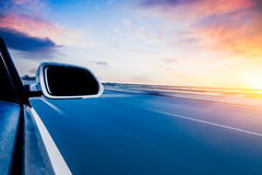 Car On The Road Whit Motion Blur Background Stock Photo