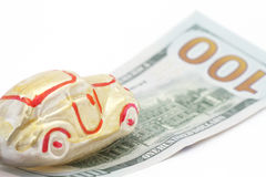 Car on one hundred dollars bill. Yellow car on one hundred dollars bill Royalty Free Stock Image