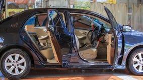 Car with open door, outdoors Stock Photo
