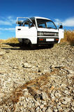 Car with open doors. On stony soil Royalty Free Stock Photography