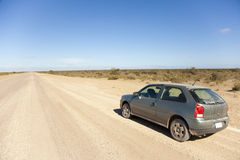 Car on an open dusty road Royalty Free Stock Images