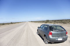 Car on an open dusty road Royalty Free Stock Image