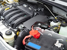 Car with open hood.Battery. Details of new car engine Stock Photos