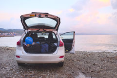 Car. With open trunk on a sea coast Stock Images