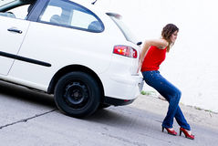 Car Out of gas. Woman pushing car out of gasoline Royalty Free Stock Photo