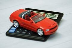 Car over a calculator Stock Photos