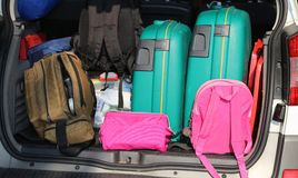 Car overloaded with suitcases and duffle bag Royalty Free Stock Photos