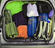 Car overloaded with suitcases and duffle bag Stock Photo