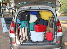 Car overloaded with suitcases and duffle bag Royalty Free Stock Photo