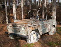 Car on painball field. Damaged car used on paintball area royalty free stock images