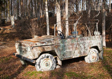 Car on painball field. Damaged car used on paintball area royalty free stock image