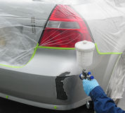 Car paint. Person with paint spray gun