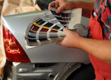 Car paint. Choosing the right color before car paint royalty free stock photography