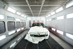 Car paint garage with car inside Stock Images