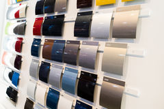 Car paint samples. The car paint samples of different colors at car dealership showroom royalty free stock photo