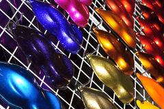 Car paint samples. Car metallic paint samples, stand with examples of glowing colors coating for different vehicles, bronze, brown, orange, purple, beige, blue royalty free stock photo