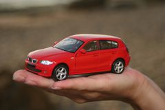 Car on a palm. Toy car on a human's palm royalty free stock image
