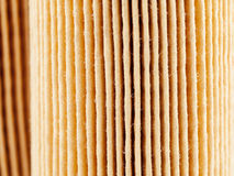 Car paper air filter surface, focus stacking. Surface of the car air filter stock photo