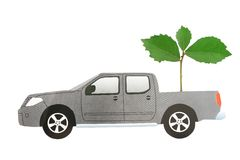 Car paper with green plant Stock Photos