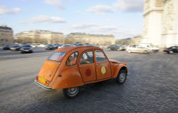 Car in paris street. Great arch with cloudy sky Stock Photography