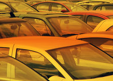 Car park. Orange filter applied to cars parked in car park Royalty Free Stock Photography