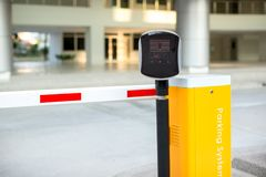 Car park automatic entry system. Security system for building access - barrier gate stop with toll booth, traffic cones.  stock photo