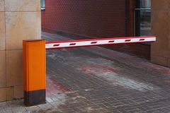 The car park barrier, the automatic entry system. The car park barrier, automatic entry system stock photography