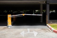 Car park barrier, automatic entry system.Security system for building access - barrier gate stop with toll booth, traffic cones an. D cctv stock image
