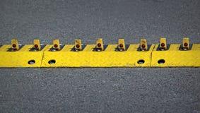 Car park barrier stinger strip Royalty Free Stock Photos