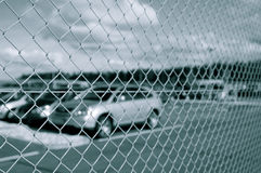 Car park behind security fence Stock Image