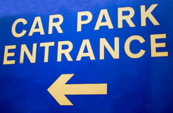 Car Park Entrance Sign. Close up of blue car park entrance sign with arrow pointing left Royalty Free Stock Images