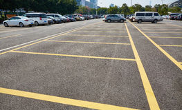 Car park parking. Public outdoor car park with cars parking on ground.  Cars parked on lot Stock Photography