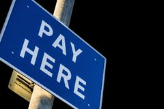 Car Park Pay Here Sign on a Pole Stock Image
