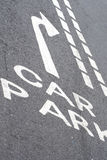Car park road sign. White painted road sign with arrow Royalty Free Stock Images