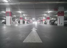 Car Park in Underground Parking Lot at Department Store. Soft Focus Royalty Free Stock Images