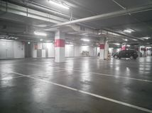 Car Park in Underground Parking Lot at Department Store. Soft Focus Stock Photography