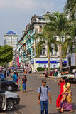 Car parked and colourful shophouses along Sule Pagoda Road in Yangon, Myanmar Royalty Free Stock Photos