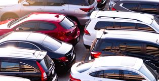 Car parked at concrete parking lot of shopping mall in holiday. Aerial view of car parking area of the mall. Automotive industry. Automobile parking space royalty free stock photography