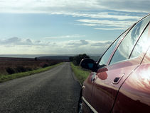 Car parked on country road.